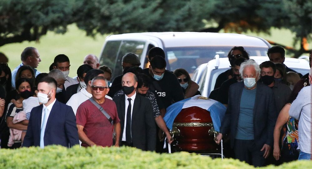 Friends and family carry the casket of soccer legend Diego Armando Maradona, at the cemetery in Buenos Aires, Argentina, 26 November 2020.