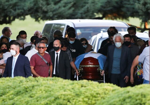 Friends and family carry the casket of soccer legend Diego Armando Maradona, at the cemetery in Buenos Aires, Argentina, November 26, 2020.