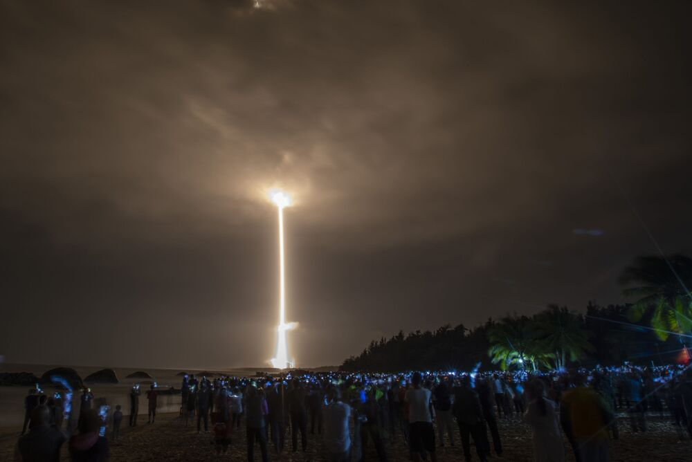 A Long March 5 rocket carrying China's Chang'e-5 lunar probe launches from the Wenchang Space Centre on China's Hainan Island on 24 November 2020, on a mission to bring back lunar rocks, the first attempt by any nation to retrieve samples from the moon in four decades.
