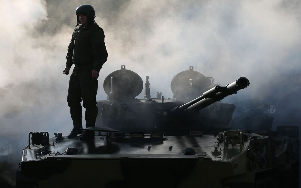 A serviceman during the ceremonial handing over of new BMD-4M airborne combat vehicles and BTR-MDM Rakushka armoured personnel carriers to the Novorossiysk airborne assault unit of the Russian Airborne Forces.