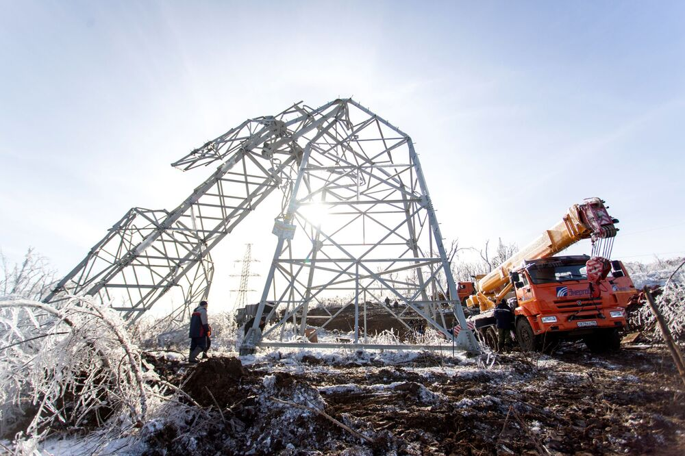 Dismantling of one of the fallen power lines in the city of Vladivostok, Russia. The authorities of Primorsky Krai have introduced a regional emergency due to a snow cyclone.