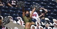 Houston Texans cheerleaders perform during the first half of an NFL football game between the Houston Texans and the New England Patriots, Sunday, 22 November 2020, in Houston.