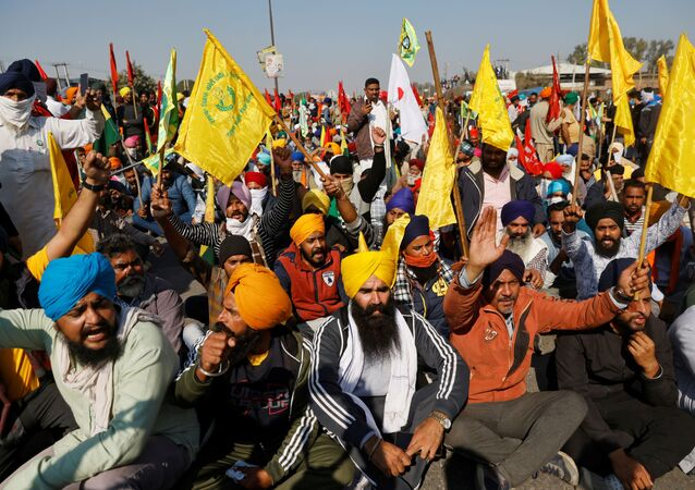 Farmers protest against the newly passed farm bills at Singhu border near Delhi, India, November 27, 2020