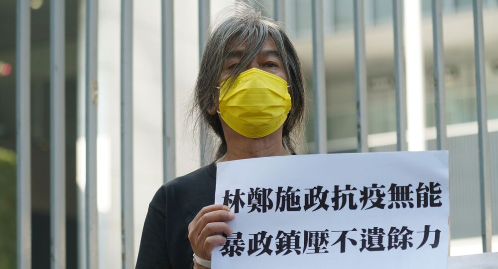Activist Long Hair Leung Kwok-hung holds a protest sign ahead of Hong Kong Chief Executive Carrie Lam's annual policy address at the Legislative Council in Hong Kong, China November 25, 2020