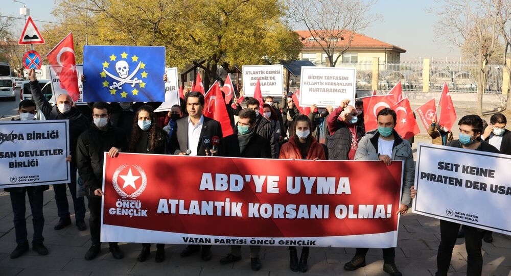 Members of the Vatan Partisi (Patriotic Party) gather near the German Embassy in Ankara, Turkey, to protest against German soldiers boarding and searching a Turkish vessel on behalf of an EU military mission in the Mediterranean Sea, 27 November 2020.