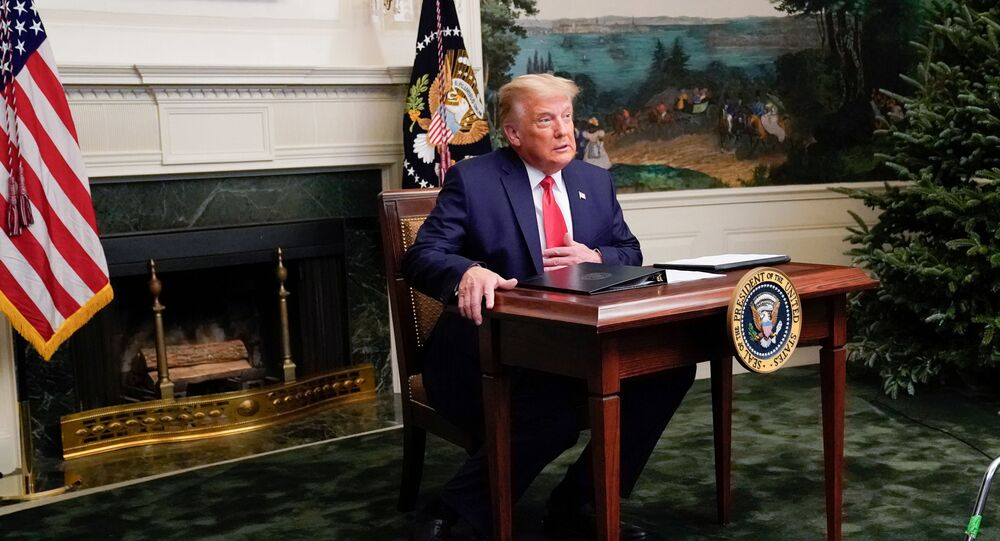 U.S. President Donald Trump arrives to a Thanksgiving video teleconference with members of the military forces at the White House in Washington, U.S., November 26, 2020. REUTERS/Erin Scott