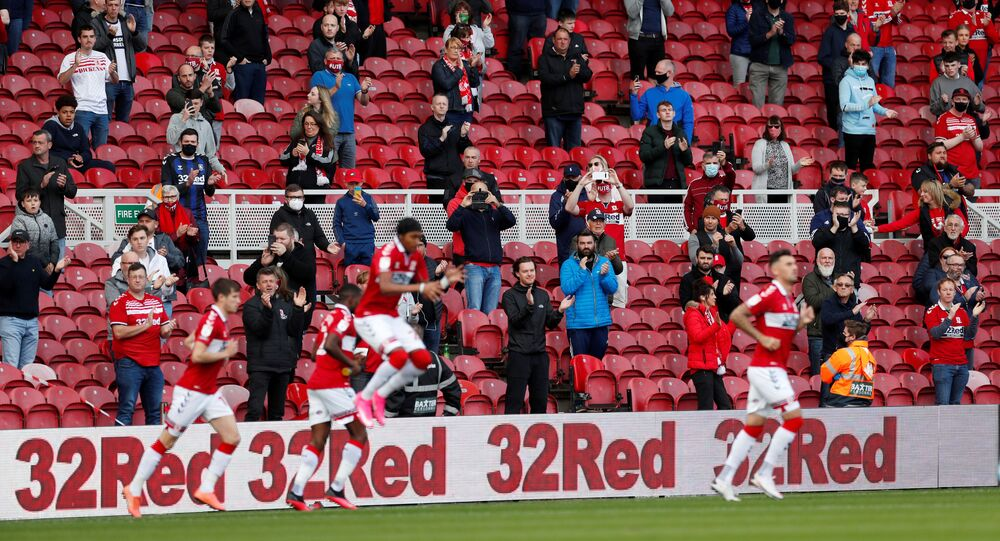 Middlesbrough fans applaud as players come out before the match as a limited number of fans are allowed to attend  September 19, 2020