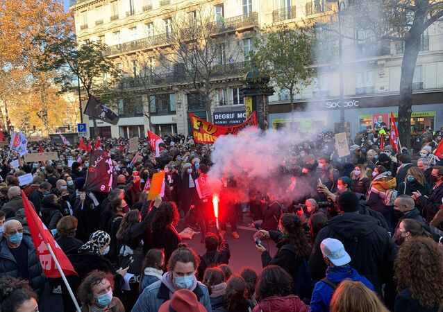 Demonstrators rally against the 'Global Security' bill in Paris, 28 November