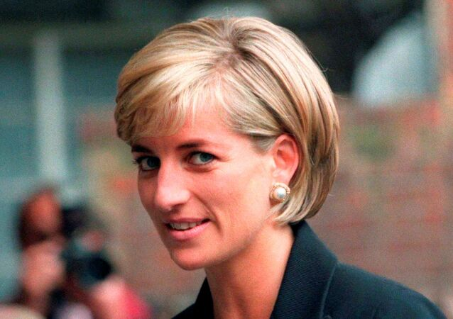 Princess Diana arrives at the Royal Geographical Society in London for a speech on the dangers of landmines throughout the world on 12 June 1997.