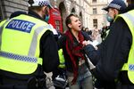 Police officers detain an anti-lockdown protestor during a demonstration amid the coronavirus disease (COVID-19) outbreak in London, Britain November 28, 2020.