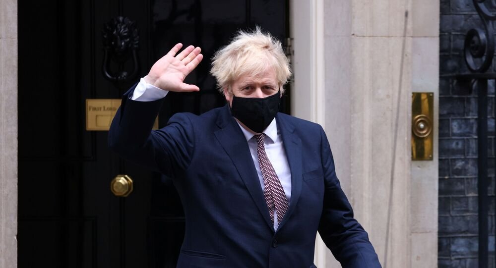 Britain's Prime Minister Boris Johnson seen in public for the first time since his self-isolation ended, leaves Downing Street during the coronavirus disease (COVID-19) outbreak in London, Britain, 26 November 2020.