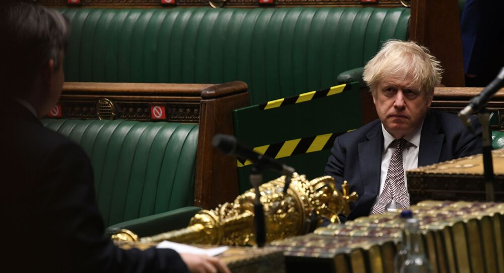 Britain's Prime Minister Boris Johnson attends a session on COVID-19 situation update at the House of Commons in London, Britain November 26, 2020.