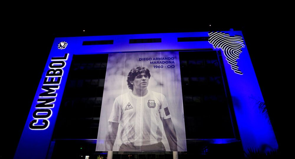 A picture of soccer legend Diego Maradona hangs in the front of the CONMEBOL headquarters following the death of Maradona, in Luque, Paraguay November 26, 2020.
