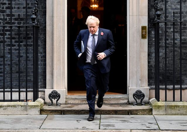 Britain's Prime Minister Boris Johnson leaves Downing Street to attend a cabinet meeting at the Foreign and Commonwealth Office (FCO) in London, Britain November 10, 2020.