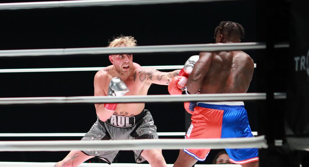 Jake Paul (grey trunks) fights Nate Robinson (red and blue trunks) during a cruiserweight boxing bout at the Staples Center