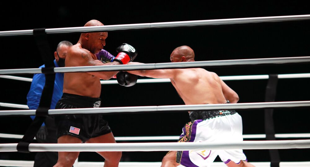 Mike Tyson (black trunks) fights Roy Jones, Jr. (white trunks) during a heavyweight exhibition boxing bout for the WBC Frontline Belt at the Staples Center.