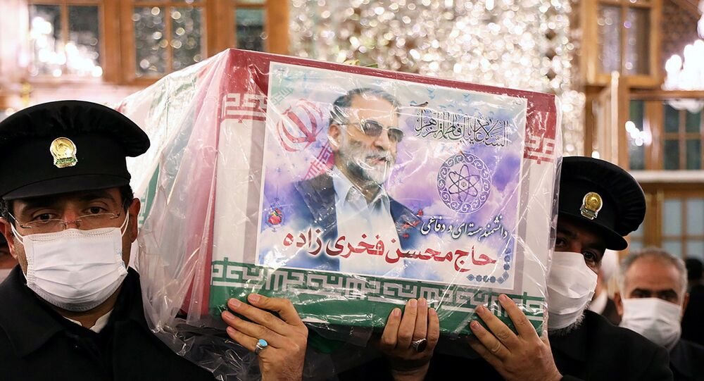 Servants of the holy shrine of Imam Reza carry the coffin of Iranian nuclear scientist Mohsen Fakhrizadeh, in Mashhad, Iran 29 November 2020