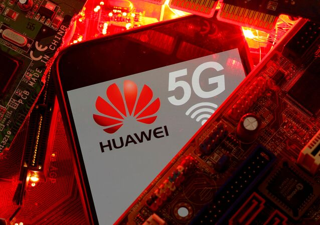 A smartphone with the Huawei and 5G network logo on a PC motherboard in this illustration taken 29 January 2020.