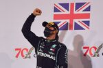 Formula One F1 - Bahrain Grand Prix - Bahrain International Circuit, Sakhir, Bahrain - November 29, 2020 Mercedes' Lewis Hamilton celebrates on the podium after winning the race