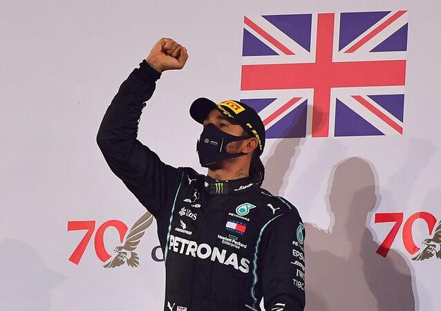 Formula One F1 - Bahrain Grand Prix - Bahrain International Circuit, Sakhir, Bahrain - November 29, 2020 Mercedes' Lewis Hamilton celebrates on the podium after winning the race
