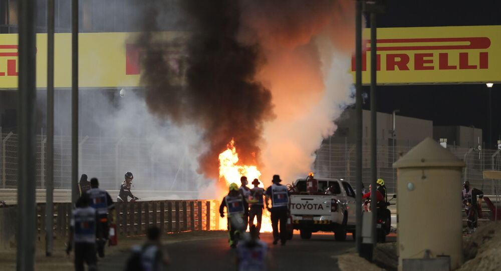 Bahrain International Circuit, Sakhir, Bahrain - November 29, 2020 Flames seen from the crash scene after Haas' Romain Grosjean crashed out at the start of the race