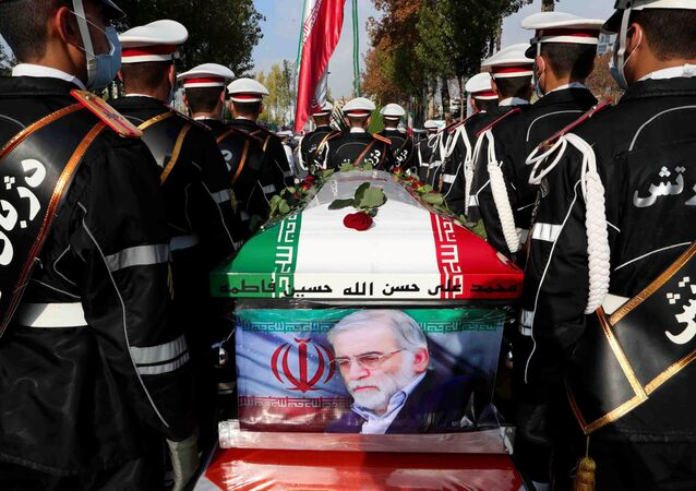 Members of Iranian forces carry the coffin of Iranian nuclear scientist Mohsen Fakhrizadeh during a funeral ceremony in Tehran, Iran November 30, 2020