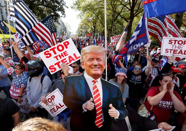 FILE PHOTO: A cut-out of US President Donald Trump is pictured as supporters take part in a protest against the results of the 2020 presidential election in Atlanta, Georgia, US, 21 November 2020.