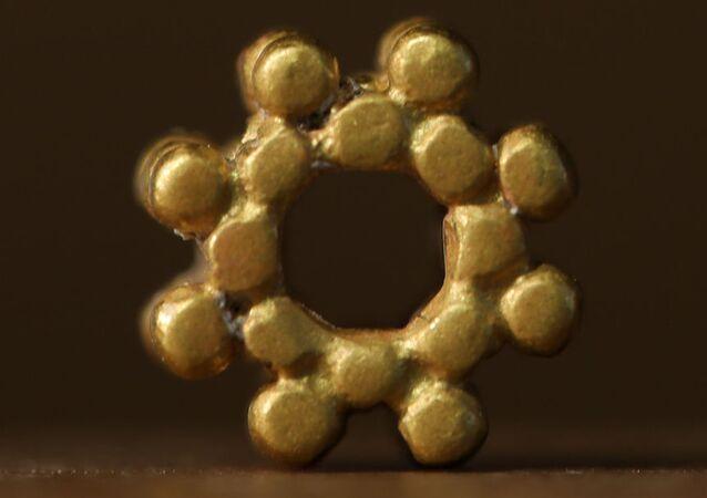 Ancient gold bead.