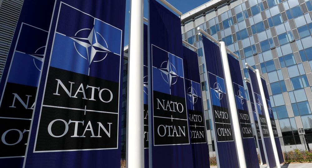 Banners displaying the NATO logo are placed at the entrance of new NATO headquarters during the move to the new building, in Brussels, Belgium April 19, 2018.