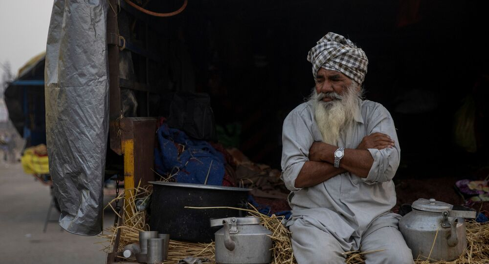 A farmer sits in a tractor trolley during a protest against the newly passed farm bills at Singhu border near Delhi, India, November 30, 2020.