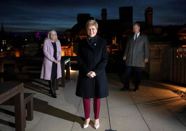 Scotland's First Minister Nicola Sturgeon flanked by Scottish National Investment Bank CEO Eilidh Mactaggart and Chair Willie Watt pose at the bank's official launch at their headquarters in Edinburgh, Scotland, Britain November 19, 2020.