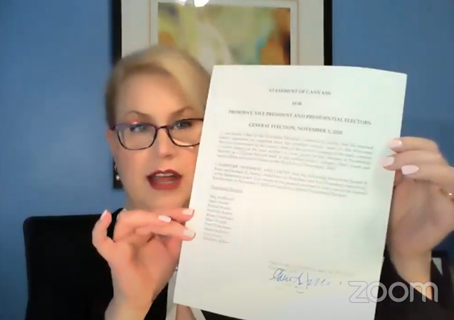 Screenshot from the video showing the head of Wisconsin Election Commission Ann Jacobs signing the official state determination of the results of the 3 November, 2020 election and the canvass