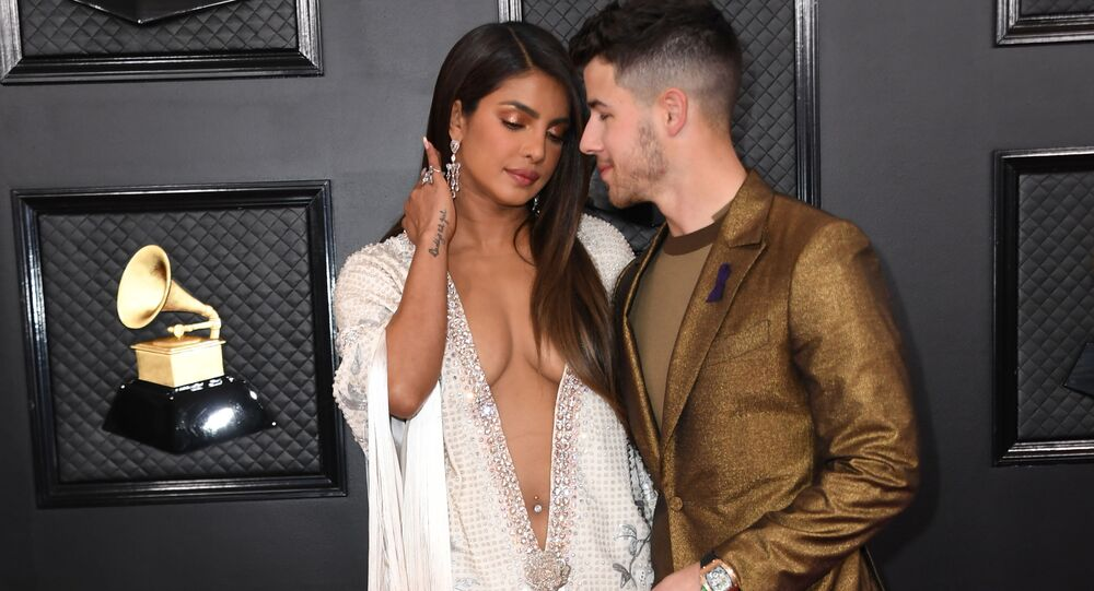 Indian actress Priyanka Chopra (L) and US singer-songwriter Nick Jonas  arrive for the 62nd Annual Grammy Awards on January 26, 2020, in Los Angeles