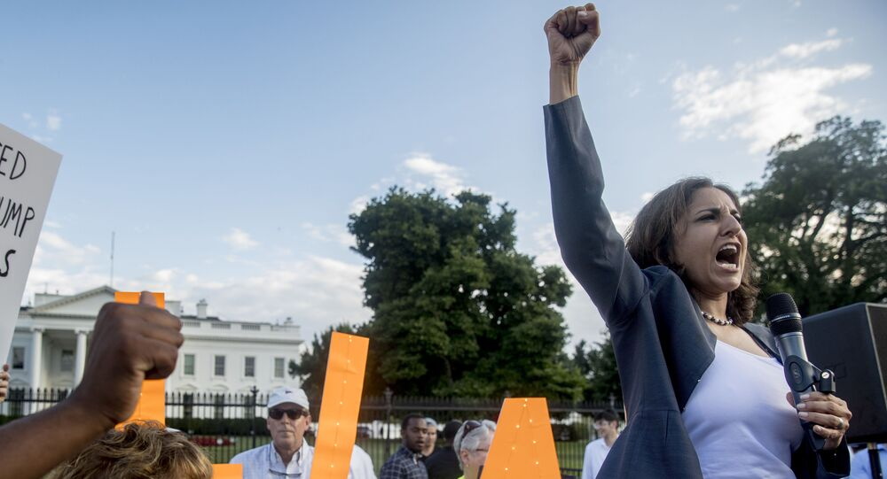Center for American Progress President Neera Tanden speaks at a protest outside the White House, Tuesday, July 17, 2018, in Washington
