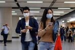 People wear masks following the coronavirus disease (COVID-19) outbreak, at the financial Central district in Hong Kong, China December 1, 2020