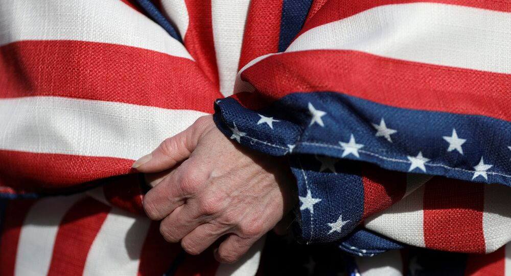 FILE PHOTO: A supporter of U.S. President Donald Trump wearing the colors of the U.S. flag participates in a Stop the Steal protest after the 2020 U.S. presidential election was called for Democratic candidate Joe Biden, in Lansing, Michigan, U.S. November 14, 2020.