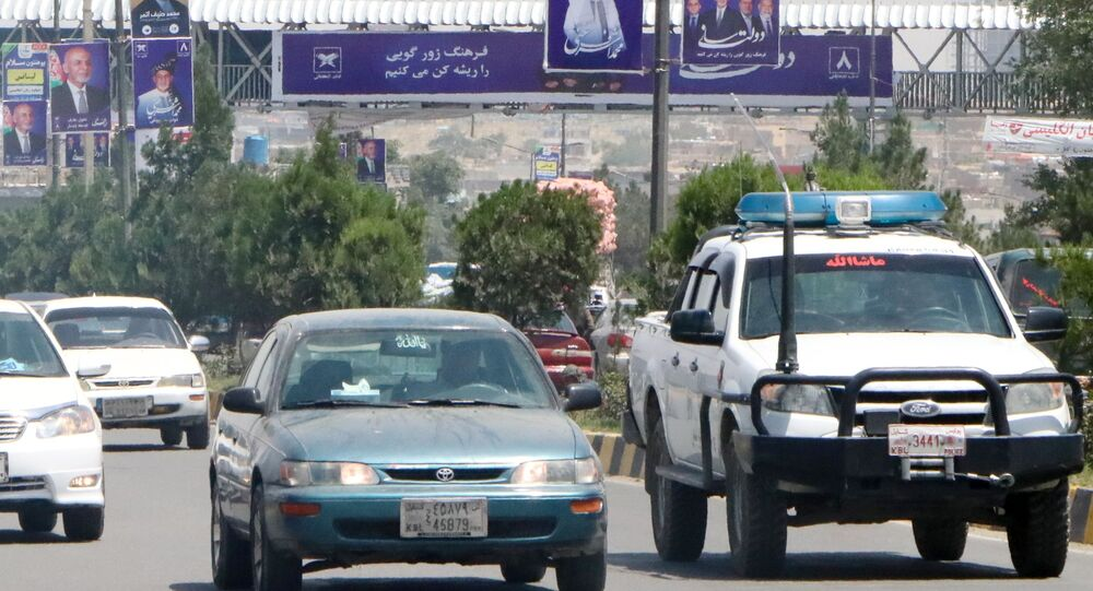 Election posters of Afghan presidential candidate and head of the ruling party Mohammad Ashraf Ghani at the highway in Kabul.