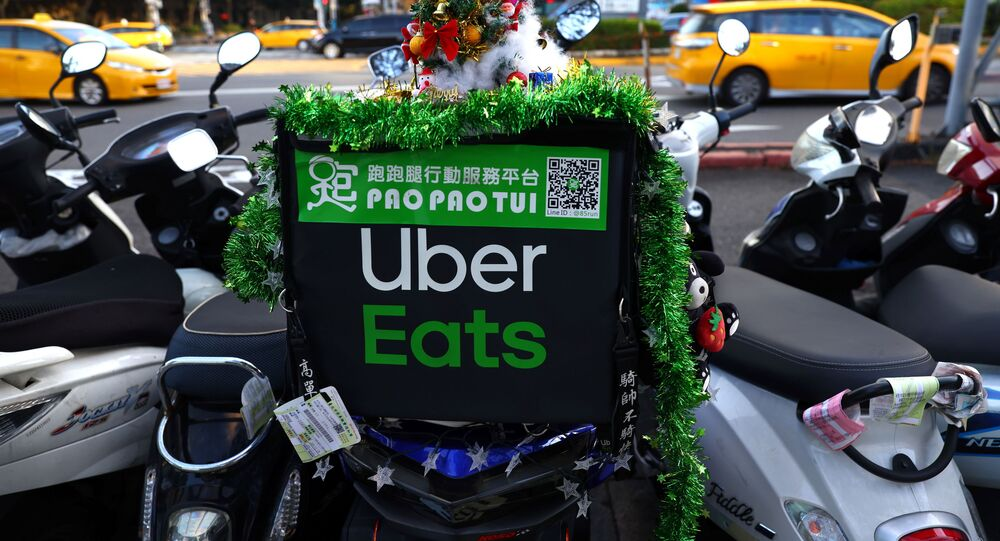 Christmas decorations can be seen on a Uber eats motobike in Taipei, Taiwan, November 26, 2020.