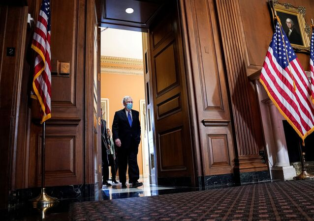 U.S. Senate Majority Leader Mitch McConnell (R-KY) arrives to face reporters as Senate Republican leaders hold a news conference on Capitol Hill in Washington, U.S., December 1, 2020