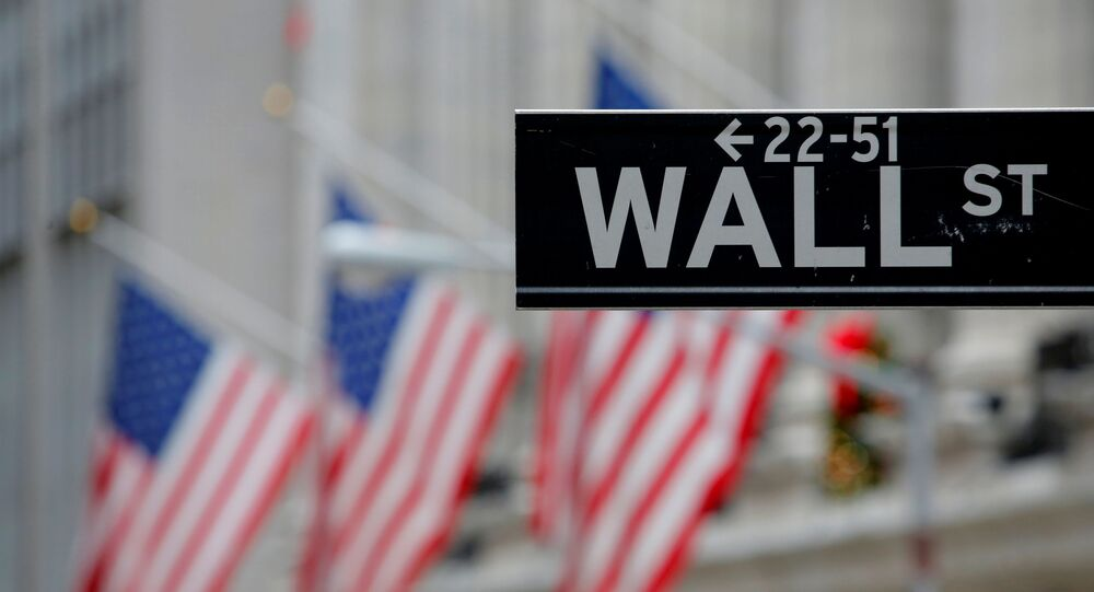 A street sign for Wall Street is seen outside the New York Stock Exchange (NYSE) in Manhattan, New York City, U.S. December 28, 2016.