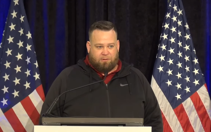 Screenshot from the video of The Amistad Project press conference, showing a truck driver Jesse Morgan delivering his remarks regarding the alleged US election fraud