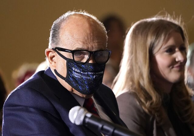 Former Mayor of New York Rudy Giuliani, a lawyer for President Donald Trump, wears a face mask to protect against COVID-19 after speaking at a hearing of the Pennsylvania State Senate Majority Policy Committee, Wednesday, Nov. 25, 2020, in Gettysburg, Pa.