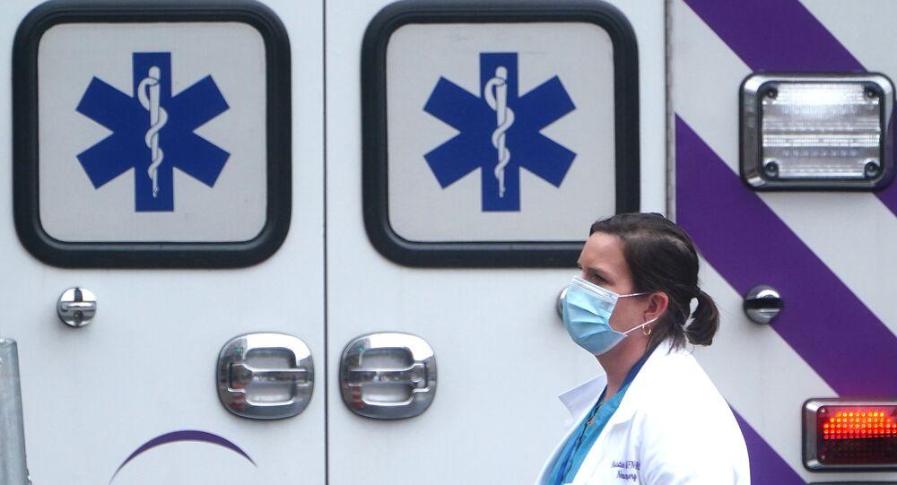 A health care professional walks past an ambulance during the coronavirus disease (COVID-19) pandemic in the Manhattan borough of New York City, New York, U.S., November 13, 2020