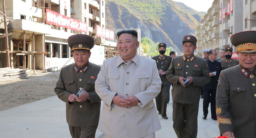This undated picture released from North Korea's official Korean Central News Agency (KCNA) on October 14, 2020 shows North Korean leader Kim Jong Un (C) inspecting the rehabilitation site in the Komdok area of South Hamgyong Province