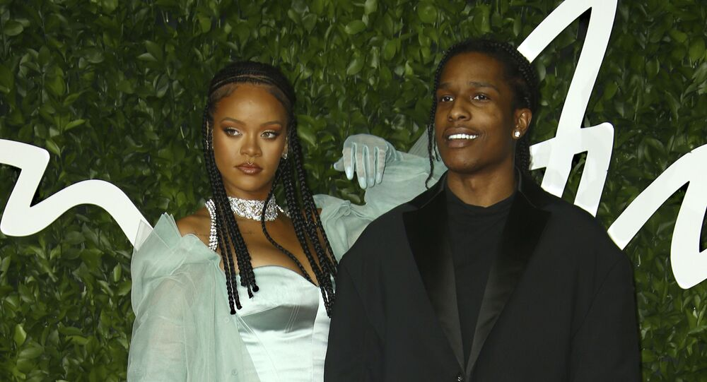 Singers Rihanna, left, and ASAP Rocky pose for photographers upon arrival at the British Fashion Awards in central London, Monday, Dec. 2, 2019