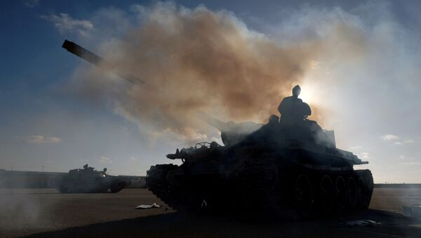 Members of Libyan National Army (LNA) commanded by Khalifa Haftar, get ready before heading out of Benghazi to reinforce the troops advancing to Tripoli, in Benghazi, Libya April 13, 2019. - Sputnik International