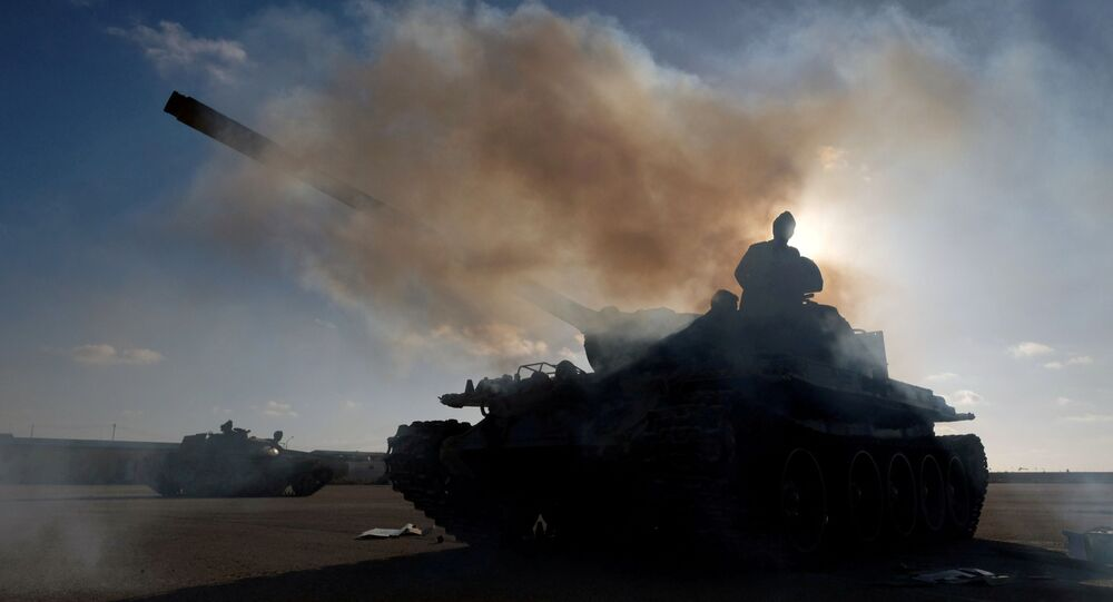 Members of Libyan National Army (LNA) commanded by Khalifa Haftar, get ready before heading out of Benghazi to reinforce the troops advancing to Tripoli, in Benghazi, Libya April 13, 2019.