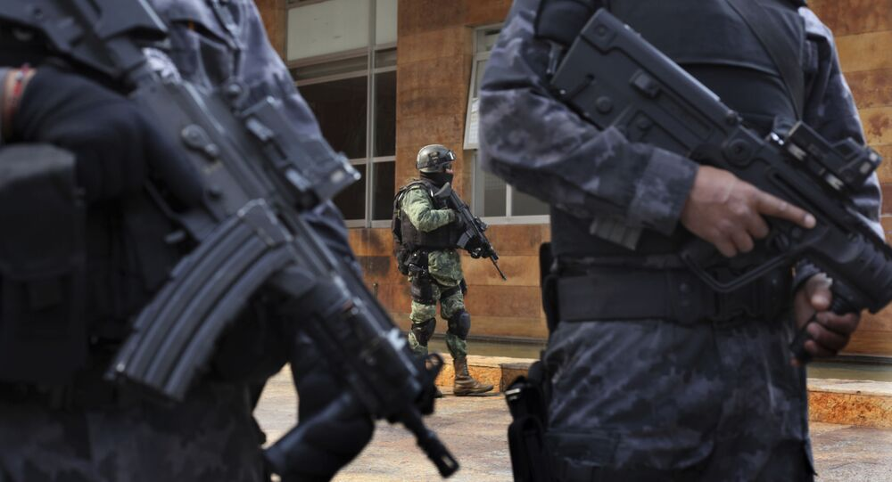 Security agents stand guard outside the apartment building where Damaso Lopez, nicknamed El Licenciado, was captured in the Anzures neighborhood of Mexico City, Tuesday, May 2, 2017