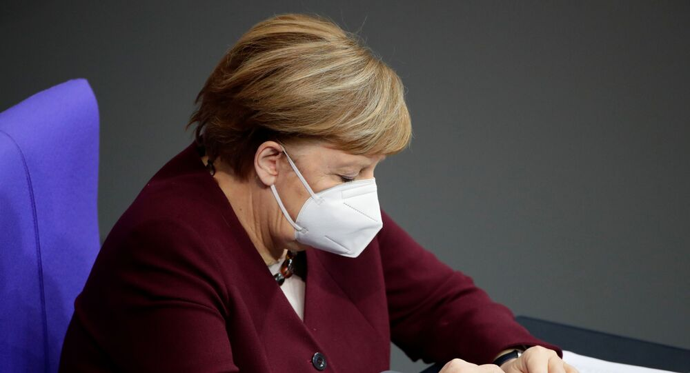 German Chancellor Angela Merkel wears a protective face mask after delivering a speech on the government's response to the coronavirus disease (COVID-19) pandemic in the country's parliament, the Bundestag, in Berlin, Germany, November 26, 2020.
