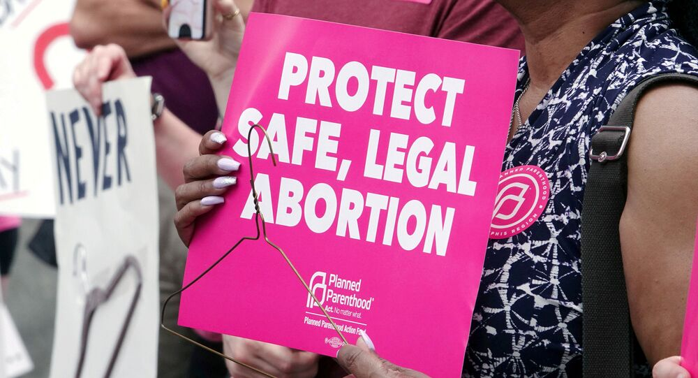 An abortion rights activist holds a sign in downtown Memphis during a Stop Abortion Bans Day of Action rally hosted by the Tennessee chapter of Planned Parenthood in Tennessee, U.S., May 21, 2019